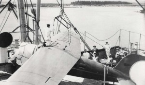 Amelia Earhart's plane was harnessed up by specially constructed slings to lift it from the deck of the Lurline, December 27, 1934.